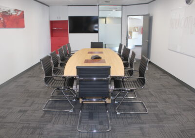 Custom made boardroom table 3600x1200 in elegant oak with south west Jarrah inserts with inbuilt power:data box, Aero visitor chairs