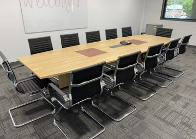 Custom made boardroom table 3600x1200 in elegant oak with south west Jarrah inserts with inbuilt power/data box, Aero visitor chairs