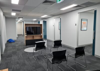 Zing visitor chair & DDK custom-made TV cabinet